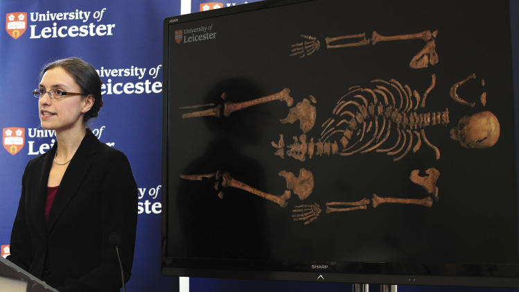 "Jo Appleby, a lecturer in Human Bioarchaeology, at University of Leicester, School of Archaeology and Ancient History, who led the exhumation of the remains found during a dig at a Leicester car park, speaks at the university Monday Feb. 4, 2013. Tests have established that a skeleton found , pictured behind, are ""beyond reasonable doubt"" the long lost remains of England's King Richard III, missing for 500 years.(AP Photo/Rui Vieira, PA)  UNITED KINGDOM OUT - NO SALES - NO ARCHIVES"