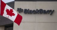 A Canadian flag flies at BlackBerry's headquarters in Waterloo, Ont., Tuesday, July 9, 2013. Fairfax Financial Holdings has offered to buy BlackBerry Ltd. Toronto-based Fairfax is offering US$9 cash for each share it doesn't already own, in a deal that values BlacKBerry at about US$4.7 billion.THE CANADIAN PRESS/Geoff Robins