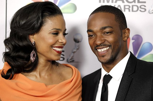 Sanaa Lathan, left, and Anthony Mackie arrive at the 43rd NAACP Image Awards on Friday, Feb. 17, 2012, in Los Angeles. (AP Photo/Matt Sayles)