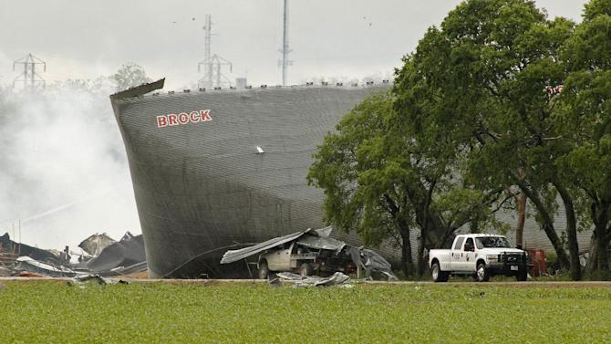 Mangled metal and crushed vehicles are all that remains at the blast site of the fertilizer company, Thursday, April 18, 2013 in West Texas.  A massive explosion at the West Fertilizer Co. killed as many as 15 people and injured more than 160, officials said overnight.  The explosion that struck around 8 p.m. Wednesday, sent flames shooting into the night sky and rained burning embers and debris down on shocked and frightened residents. (AP Photo/The Fort Worth Star-Telegram, Paul Moseley)  MAGS OUT; (FORT WORTH WEEKLY, 360 WEST)