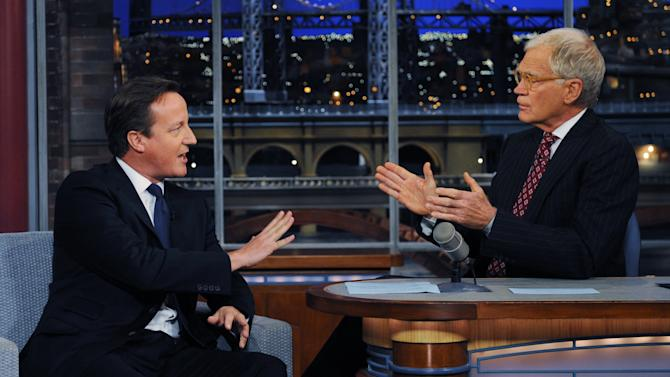 Britain's Prime Minister David Cameron (left) talks with talk show host David Letterman on the David Letterman Show  after he addressed the United Nations General Assembly, in New York, Wednesday, Sept. 26, 2012. (AP Photo / Stefan Rousseau/PA) UNITED KINGDOM OUT: NO SALES: NO ARCHIVE: