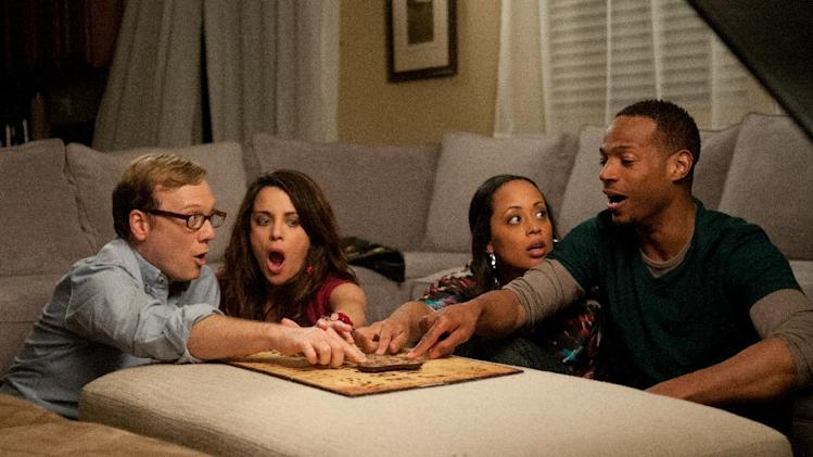 "This film image released by Open Road Films shows, from left, Andrew Daly, Marlene Forte, Essence Atkins, and Marlon Wayans in a scene from ""A Haunted House."" (AP Photo/Open Road Films, Will McGarry)"