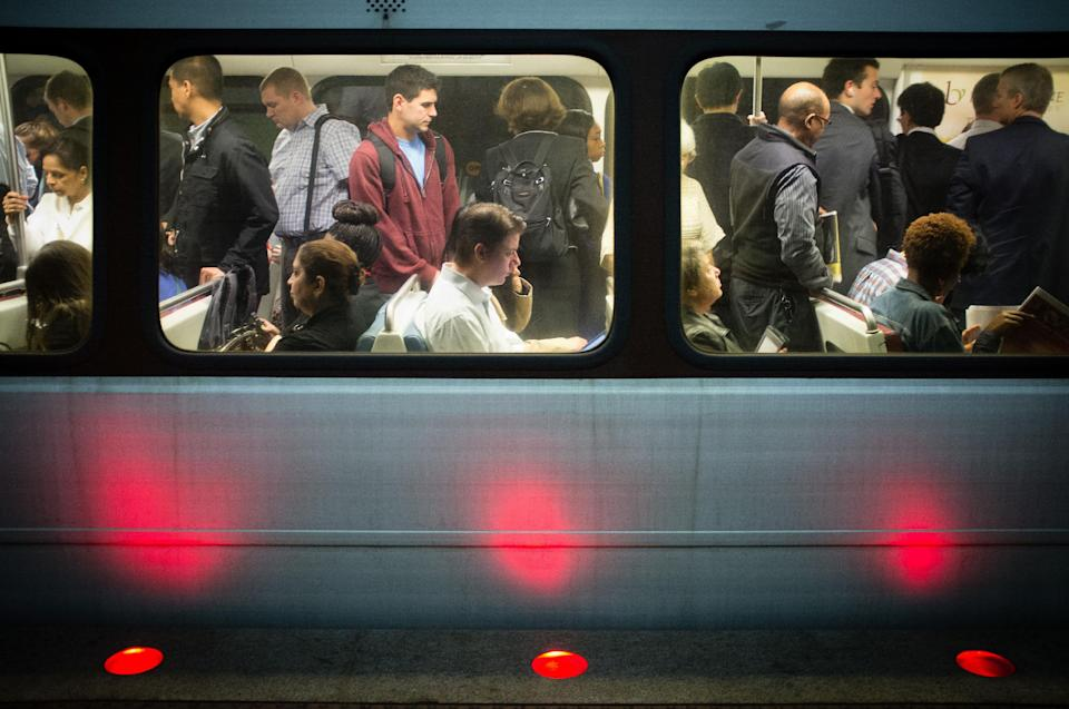 Passengers fill up Washington Metro subway cars in Arlington, Va., Thursday, Oct. 17, 2013 as workers return to their jobs after a budget fight on Capitol Hill that resulted in a partial government shutdown is resolved. (AP Photo/J. David Ake)