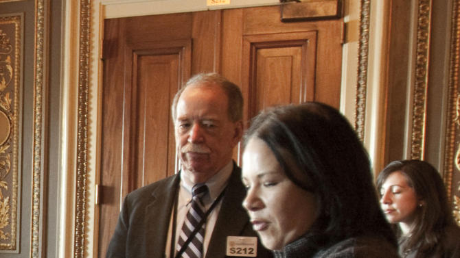 FILE - In this Dec. 23, 2009 file photo, Michael Hash of HHS, left, and White House health reform director Nancy-Ann DeParle, are seen on Capitol Hill in Washington. Republican governors who've balked at creating new consumer health insurance markets under President Barack Obama's health care law may end up getting stuck .  Instead of their state officials retaining some control over insurance issues that states traditionally manage, Washington could be calling the shots. (AP Photo/Harry Hamburg, File)