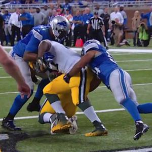 Detroit Lions linebacker DeAndre Levy tackles Green Bay Packers running back Eddie Lacy for a safety