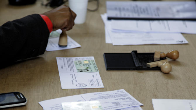 A worker stamps voting cards at a polling station in Antwerp, Belgium, on Sunday Oct. 14, 2012. NVA, a separatist party, wants to use Antwerp as a base for breaking away from Belgium, putting it in the forefront of a European breakaway trend just as the EU celebrates winning the Nobel Peace Prize for fostering continental unity. (AP Photo/Virginia Mayo)