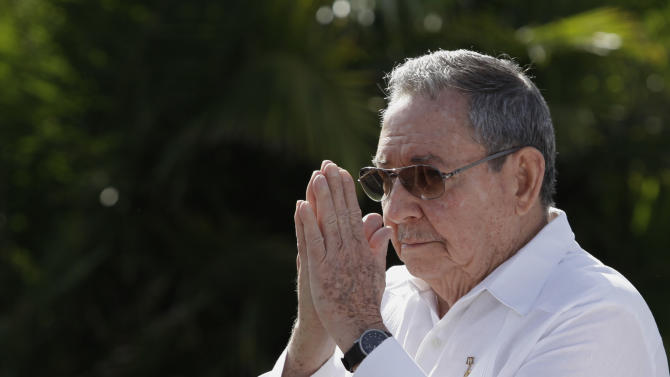 """Cuba's President Raul Castro, center, gestures goodbye to reporters after answering a few question outside the Internationalist Soviet soldier mausoleum where he attended a tribute with the visiting Prime Minister of Russia, Dmitry Medvedev, in Havana, Cuba, Friday, Feb. 22, 2013. The Cuban leader raised the possibility of leaving his post, during an appearance Friday. Castro told reporters he's about to turn 82 years old and added, """"I have the right to retire, don't you think?"""" (AP Photo/Franklin Reyes)"""
