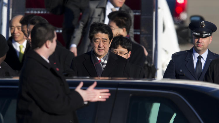 Japanese Prime Minister Shinzo Abe, center, arrives at Andrews Air Force Base, Md., Thursday, Feb. 21, 2013.  The Japanese prime minister is meeting President Barack Obama on Friday. (AP Photo/Manuel Balce Ceneta)