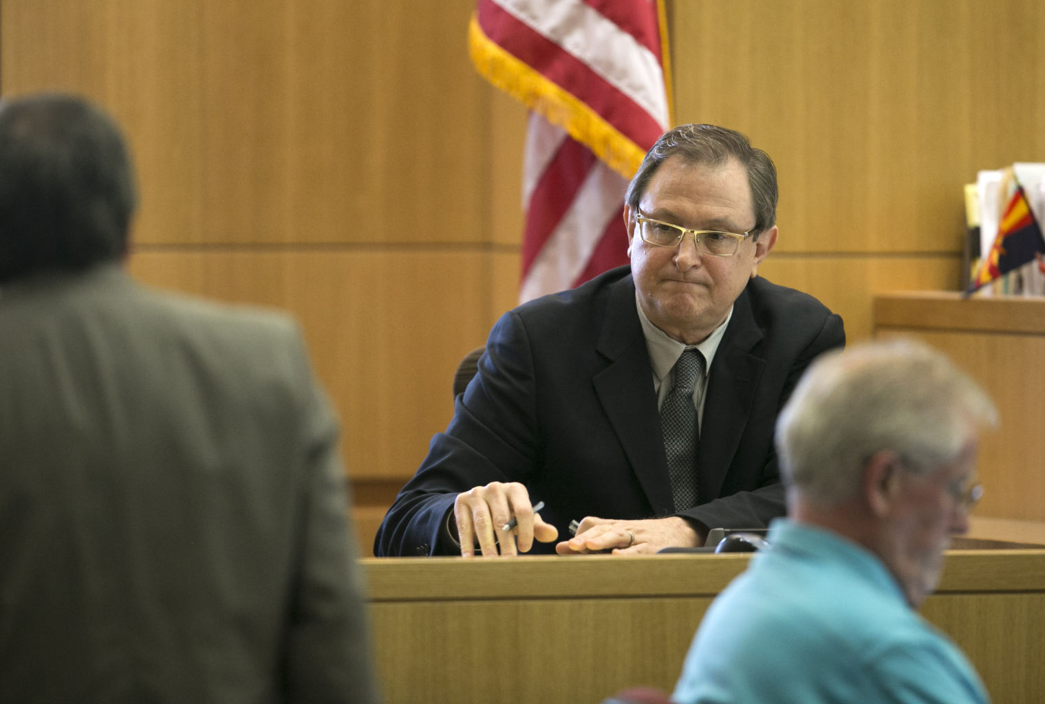 witness for the defense, is cross examined by Prosecutor Juan Martinez ...