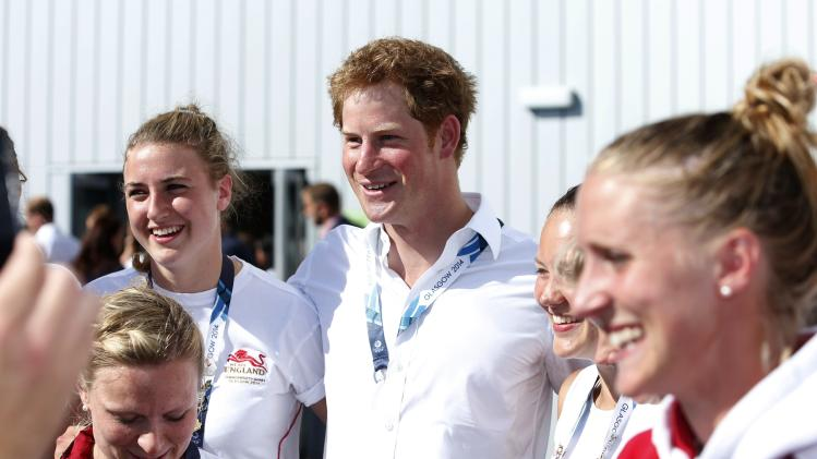 Britain's Prince Harry meets players and staff before the Wales versus Scotland group B preliminary round of the womens hockey during the 2014 Commonwealth Games in Glasgow