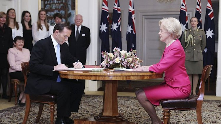 Tony Abbott (L) is sworn in as prime minister of Australia by Governor-General Quentin Bryce (R) on September 18, 2013