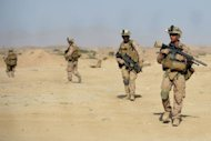 US Marines patrol Sangin in Helmand province. Afghan President Hamid Karzai has called for greater international cooperation to stabilise his war-torn country, during the latest round of talks on the future of Afghanistan