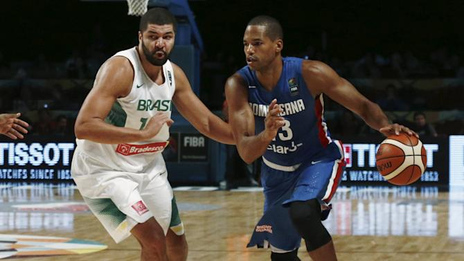 Dominican Republic's Baez dribbles the ball against Brazil's Olivinha during their 2015 FIBA Americas Championship basketball game in Mexico City
