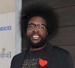 "FILE - In this June 8, 2013 file photo, Questlove arrives at Spike TV's Guys Choice Awards at Sony Pictures Studios in Culver City, Calif. The Roots leader is executive producing a music series for VH1 that will feature three artists performing simultaneously on one stage. ""SoundClash"" debuts July 23, 2014, with Lil Wayne, Fall Out Boy and buzzed British group London Grammar. (Photo by Frank Micelotta/Invision/AP, File)"