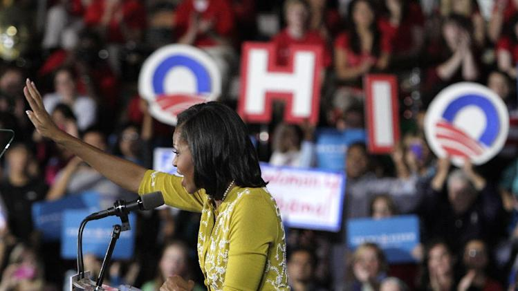 First lady Michelle Obama campaigns for her husband, President Barack Obama, Monday, Oct. 15, 2012, at Ohio Wesleyan University in Delaware, Ohio. (AP Photo/Jay LaPrete)
