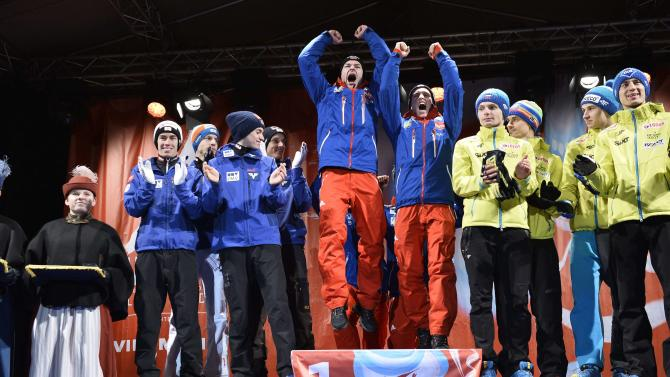 The ski jumping teams of Austria, Norway and Poland celebrate during the medal ceremony after the men's large hill team ski jumping final at the FIS Nordic Skiing World Championships in central Falun