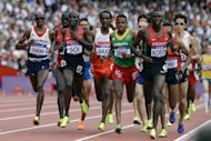 Athletes compete in the men&#39;s 5000m heats at the athletics event of the London 2012 Olympic Games. Farah remained on course for a distance double after safely negotiating his passage into the final of the 5000m