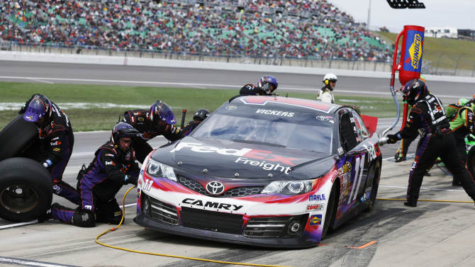 Brian Vickers (11) pits during a NASCAR Sprint Cup series auto race at Kansas Speedway in Kansas City, Kan., Sunday, April 21, 2013. (AP Photo/Orlin Wagner)
