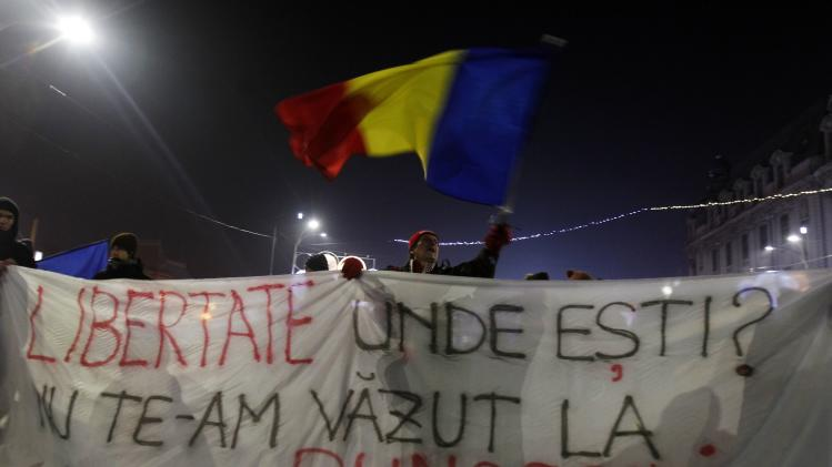 A man waves a Romanian national flag during a protest in Bucharest