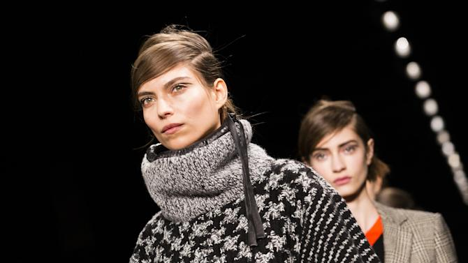 A model walks the runway at the presentation of the Rag & Bone Fall 2013 fashion collection during Fashion Week, Friday, Feb. 8, 2013, in New York. (AP Photo/John Minchillo)