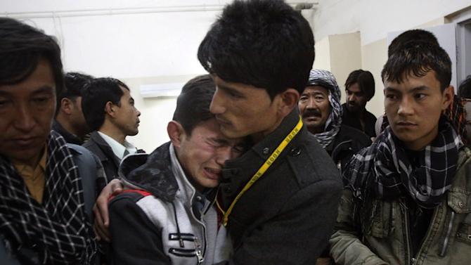 A Pakistani man comforts another mourning for a family member who died in a bomb blast, at local hospital in Quetta, Pakistan on Saturday, Feb. 16, 2013. Senior police officer Wazir Khan Nasir said the bomb went off in a Shiite Muslim-dominated residential suburb of the city of Quetta. Residents rushed the victims to three different hospitals.(AP Photo/Arshad Butt)