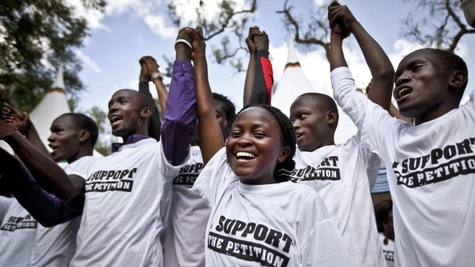 "Supporters of Kenyan presidential candidate Raila Odinga attend the launch of their campaign of social media protest and prayer vigils entitled ""Democracy on Trial"", which is due to last until the country's highest court has ruled on petitions challenging the validity of the recent election, in Nairobi, Kenya, Friday, March 15, 2013. Odinga has said he will challenge the result of the recent elections in the courts, alleging widespread irregularities, and that lawyers for his party will file a petition to the Kenyan Supreme Court by the end of the week. (AP Photo/Ben Curtis)"