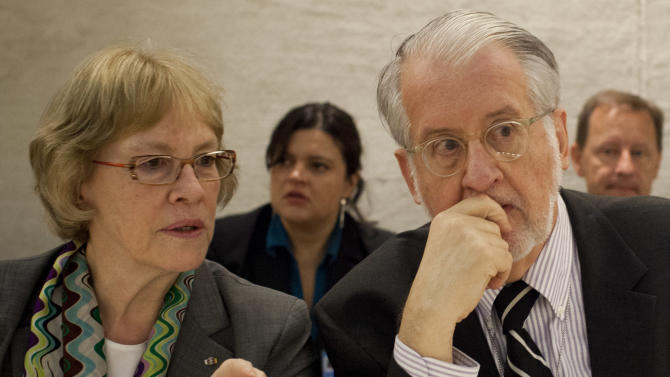 """Brazilian diplomat Paulo Sergio Pinheiro, right, talks to Karen Koning AbuZayd, Member of Commission of Inquiry, before delivering the report of the Independent Commission of Inquiry on Syria during to the Human Rights Council at the United Nations in Geneva, Switzerland, Monday, Sept. 17, 2012.  An increasing number of """"foreign elements"""" including jihadis are now operating in Syria, an independent U.N. panel confirmed Monday in its first report to say that outside """"terrorists"""" have joined a war spiraling out of control. (AP Photo/Anja Niedringhaus)"""