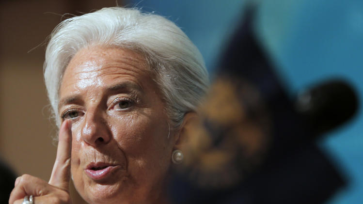 IMF Managing Director Christine Lagarde gestures during a news conference at a Tokyo hotel Friday, July 6, 2012. Lagarde has praise for Japan's move to raise its sales tax to curb the swollen national debt. (AP Photo/Itsuo Inouye)