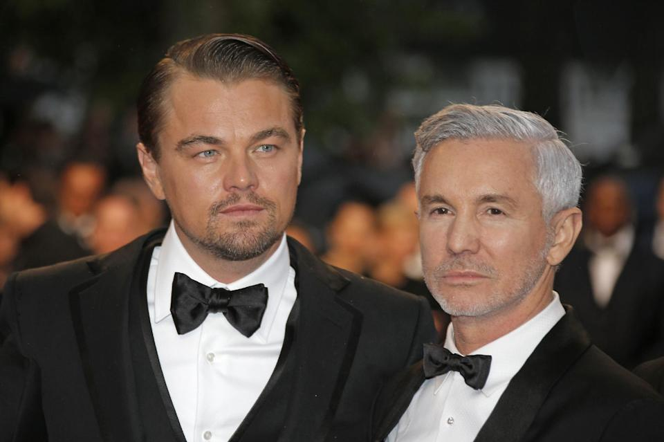 Actor Leonardo DiCaprio, left, and director Baz Luhrmann arrive for the opening ceremony and the screening of The Great Gatsby at the 66th international film festival, in Cannes, southern France, Wednesday, May 15, 2013. (AP Photo/Lionel Cironneau)