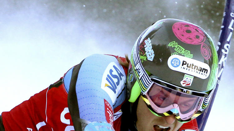 Ted Ligety, of the United States, competes on his way to set the fastest time during the first run of an alpine ski, men's World Cup giant slalom, in Alta Badia, Italy, Sunday, Dec. 16, 2012. (AP Photo/Alessandro Trovati)