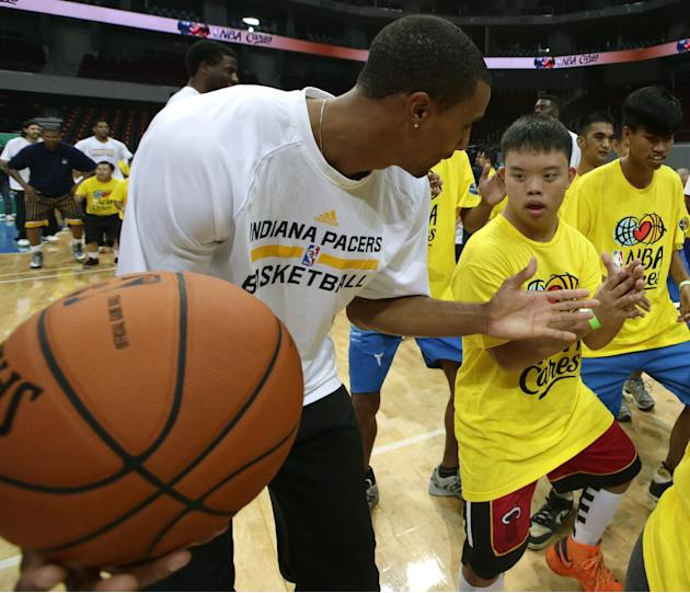 Indiana Pacers' George Hill conducts a basketball clinic for Filipino Special Olympics athletes Wednesday, Oct. 9, 2013, at the Mall of Asia Arena in Pasay city, south of Manila, Philippines. The Indi