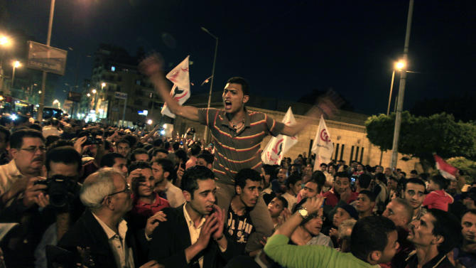 Egyptians chant slogans during a protest in front of the Coptic cathedral to condemn Saturday's sectarian clashes in Cairo, Egypt, Tuesday, April 9, 2013. Four Christians, along with a Muslim, were killed in clashes on Saturday in a town north of Cairo. Coptic Christians make up about 10 percent of Egypt's estimated 90 million people. They have long complained of discrimination. Attacks against Christians have increased since the ouster two years ago of autocrat Hosni Mubarak. (AP Photo/Khalil Hamra)