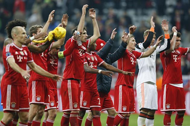 Bayern players celebrate advancing to the quarterfinal after the Champions League round of 16 second leg soccer match between FC Bayern Munich and FC Arsenal in Munich, Germany, Wednesday, March 12, 2
