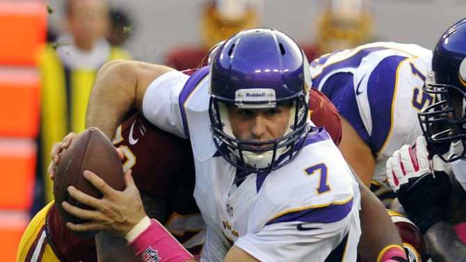 Washington Redskins defensive end Stephen Bowen (72) and linebacker Lorenzo Alexander (97) combine to sack Minnesota Vikings quarterback Christian Ponder (7) during the first half of an NFL football game, Sunday, Oct. 14, 2012, in Landover, Md. (AP Photo/Richard Lipski)