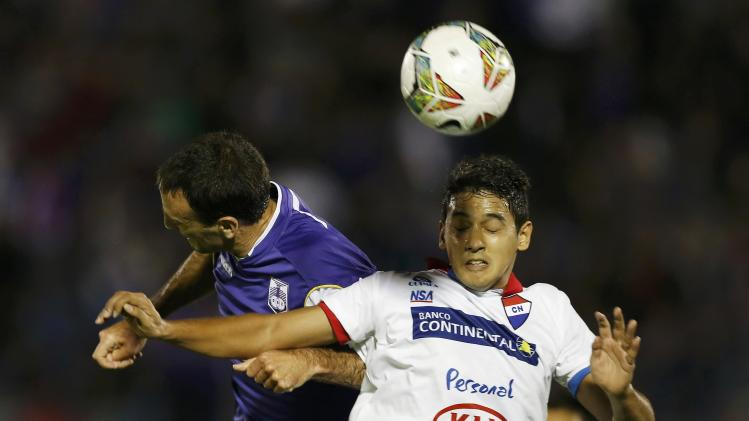 Torales of Paraguay's Nacional battles Risso of Uruguay's Defensor Sporting during their Copa Libertadores semi-final soccer match in Montevideo