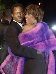 FILE - In this March 25, 2001 file photo, Bobby Brown and his then wife Whitney Houston arrive at Vanity Fair's Oscar party at Morton's in Hollywood on Sunday, March 25, 2001. Houston, who ruled as pop music's queen until her majestic voice was ravaged by drug use and her regal image was ruined by erratic behavior and a tumultuous marriage to singer Bobby Brown, died Saturday Feb. 11, 2012. She was 48. (AP Photo/Laura Rauch)
