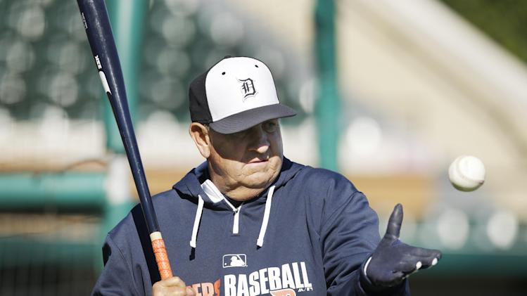 Detroit Tigers bench coach Gene Lamont prepares to hit during warm up drills before a spring exhibition baseball game against the Miami Marlins in Lakeland, Fla., Thursday, March 13, 2014. (AP Photo/Carlos Osorio)