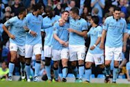 Manchester City's James Milner (4th left) is congratulated by his teammates after scoring against Sunderland during the side's Premier League match at the Etihad stadium. Manchester City got back on track after their recent struggles as the Premier League champions cruised to a 3-0 win over Sunderland