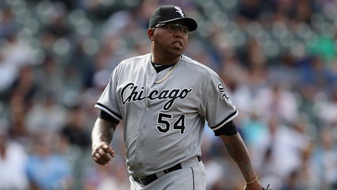 Ronald Belisario fractured his left shoulder climbing out of hi…