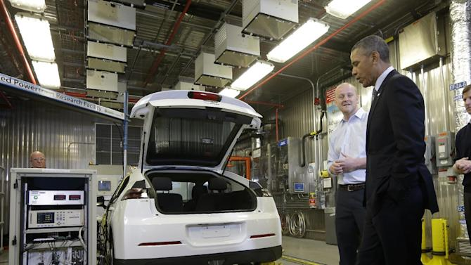 President Barack Obama listens to Research Engineer Henning Lohse-Busch as he explains electric car technology during the president's tour of the Argonne National Laboratory in Argonne, Ill., Friday, March 15, 2013. Argonne is the first US science and engineering research national laboratory, and it remains on of the nation's largest. (AP Photo/Pablo Martinez Monsivais)