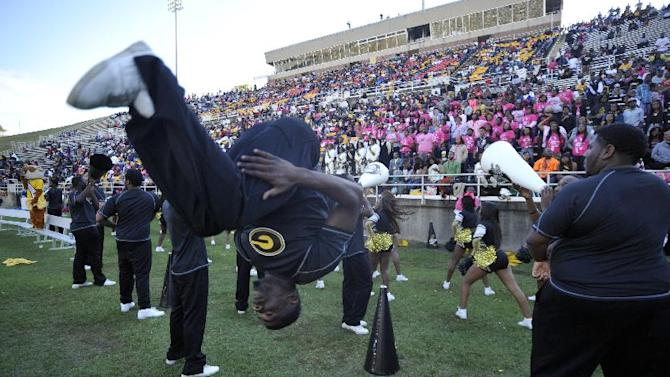 FILE - In this Saturday, Oct. 26, 2013, file photo, Grambling State cheerleaders perform their routines in the second half of an NCAA college football game against Texas Southern, in Grambling, La. After a turmoil-filled 2013 season, the Grambling football team is back to its winning ways, and will be playing for a spot in the league championship game when they face Southern on Saturday, Nov. 29, 2014, in the Bayou Classic in New Orleans. (AP Photo/Kita Wright, File)