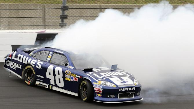 Jimmie Johnson (48) hits the wall during a NASCAR Sprint Cup Series auto race at Kansas Speedway in Kansas City, Kan., Sunday, Oct. 21, 2012. (AP Photo/Colin E. Braley)