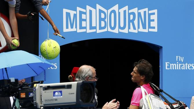 Nadal of Spain looks up at the crowd as he leaves the court after being defeated by Berdych of the Czech Republic during their men's singles quarter-final match at the Australian Open 2015 tennis tournament in Melbourne