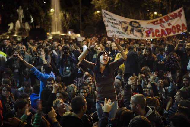 Protestors shout during a demonstration near the Spanish Parliament against austerity measures announced by the Spanish government in Madrid, Spain, Wednesday, Sept. 26, 2012. Spain's Parliament has t