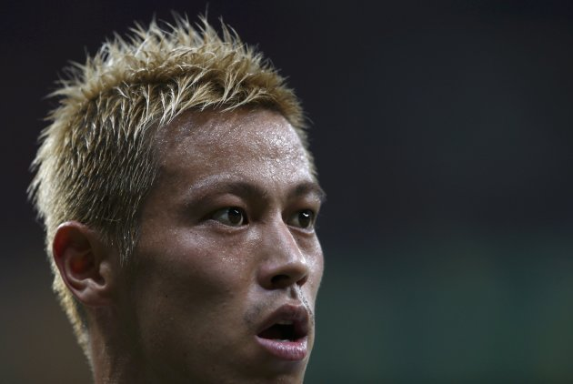 Japan's Keisuke Honda reacts after their Confederations Cup Group A soccer match against Italy at the Arena Pernambuco in Recife June 19, 2013. REUTERS/Marcos Brindicci (BRAZIL  - Tags: SPORT SOCCER)