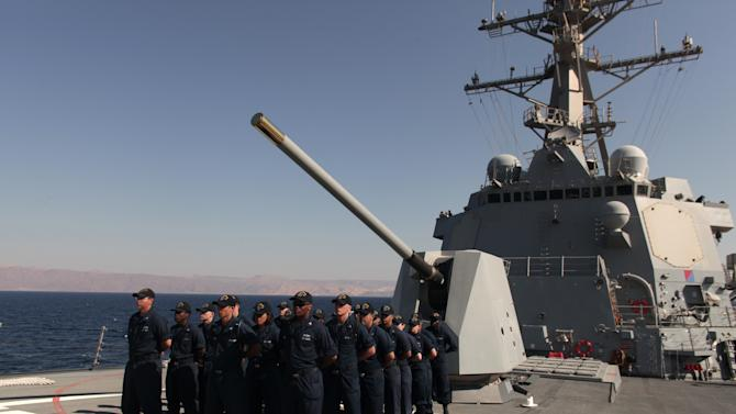 U.S. Navy sailors stand in formation aboard the USS Stockdale before maneuvers with the Jordanian Navy in the Gulf of Aqaba, Jordan as part of Eager Lion, a multinational military exercise, Tuesday, June 18, 2013. Under the watchful eye of stern-faced American advisers, hundreds of U.S.-trained Jordanian soldiers are holding war games that could eventually form the basis of an assault in Syria. There is fear of spillover from the Syrian war in this U.S.-allied kingdom, and the potential for a Jordanian role in securing Syria's chemical stockpiles should Bashar Assad's regime lose control.(AP Photo/Maya Alleruzzo)