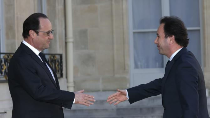 French President Francois Hollande welcomes Khaled Khoja, president of the National Coalition for Syrian Revolutionary and Opposition Forces, at the Elysee Palace in Paris