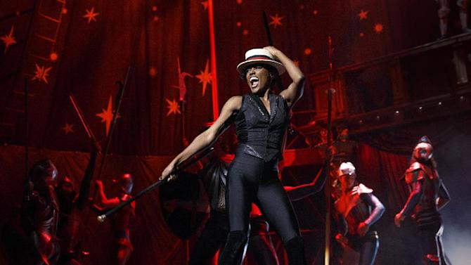 "This theater image released by Boneau/Bryan-Brown shows Patina Miller during a performance of ""Pippin,"" at Broadway's Music Box Theatre in New York. Producers of the Tony Award-nominated show said Wednesday, May 15, 2013, that a national tour will kick off in September 2014 at the Buell Theatre in Denver.  (AP Photo/Boneau/Bryan-Brown, Joan Marcus)"