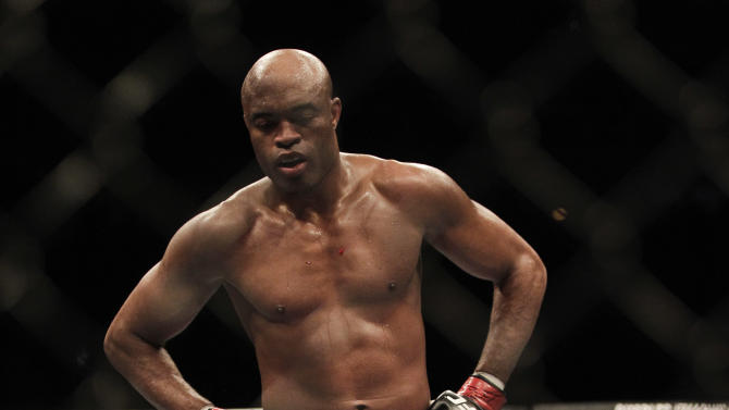 Defending middleweight champion Anderson Silva of Brazil challenges Japan's Yushin Okami in the middleweight title bout at the Ultimate Fighting Championship (UFC) 134 in Rio de Janeiro, Brazil, Saturday Aug. 27, 2011. Silva knocked out Okami in the second to defend his title. (AP Photo/Felipe Dana)