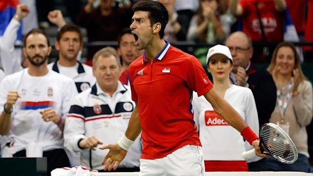 Novak Djokovic of Serbia celebrates winning the first set during the mens singles match between Novak Djokovic of Serbia and Tomas Berdych of Czech Republic (Getty Images)